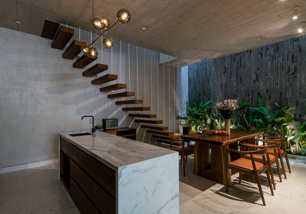 In the kitchen and dining area there's a stylish floating staircase hanging from the ceiling by thin metal rods
