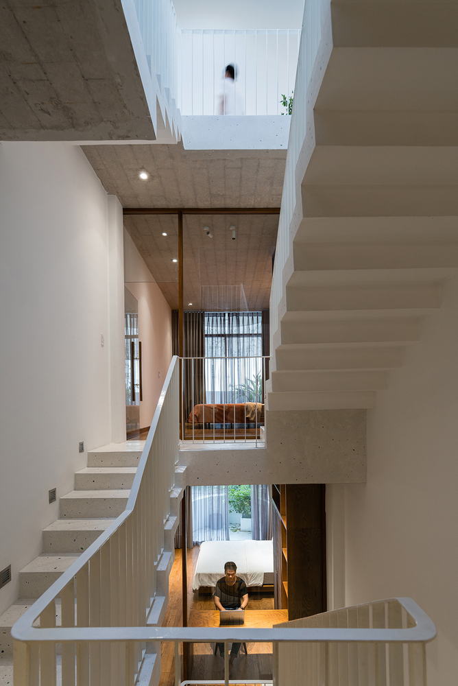 This alternative staircase connects the bedrooms and brings more light from above