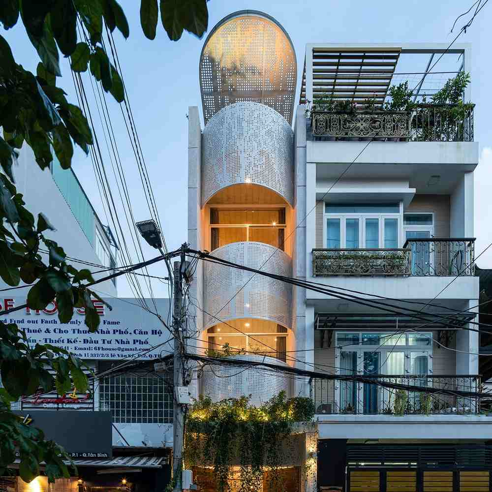 The LVS.House is tall and narrow, featuring a tower or tube-like shape