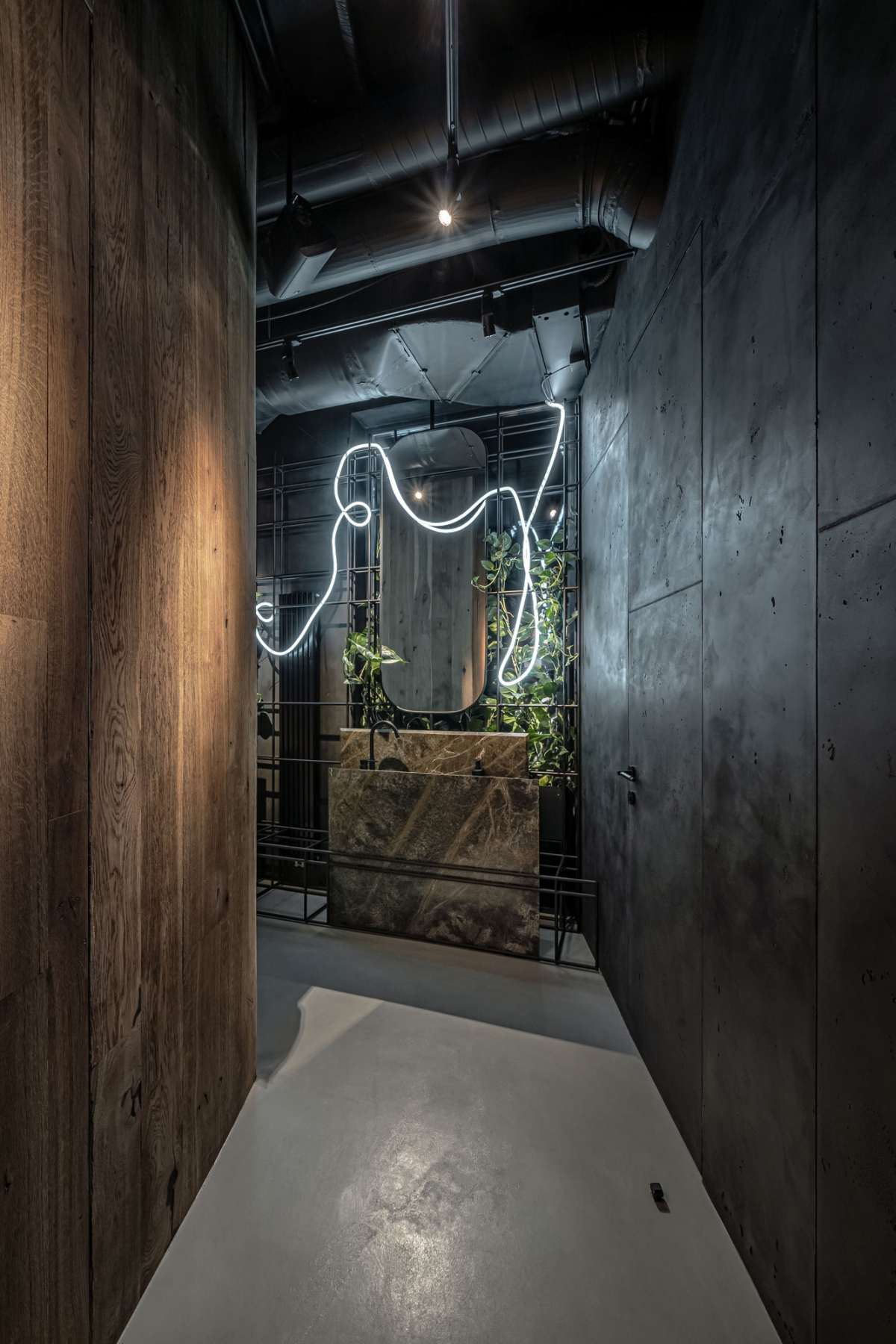 The restrooms also have the same organic and cozy design and feature stone washbasins