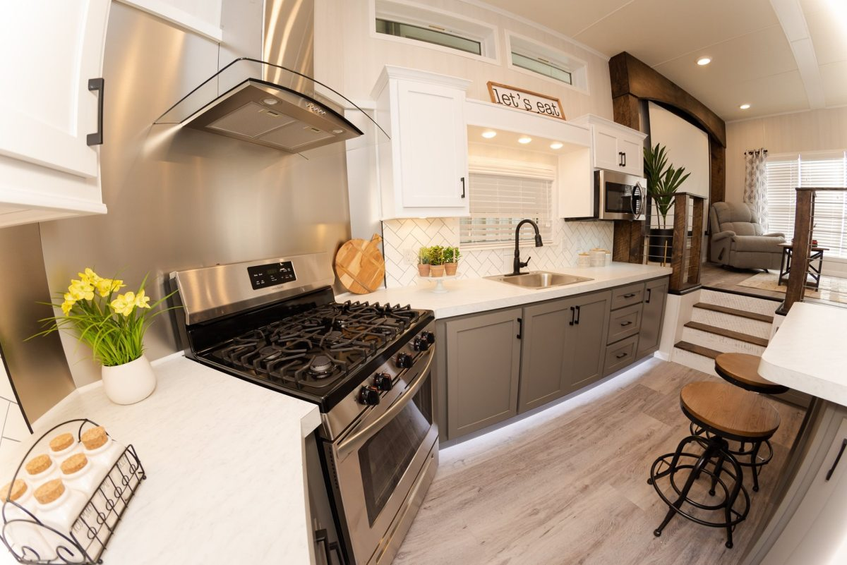 There are full-size appliances cleverly integrated into the design in a practical and convenient way