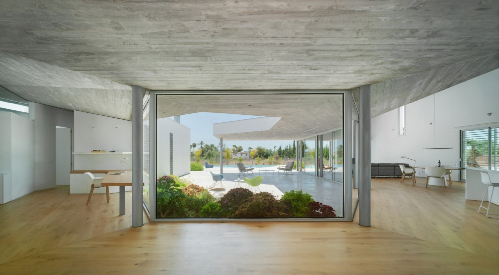 The innermost section of the courtyard is framed by full-height glass walls
