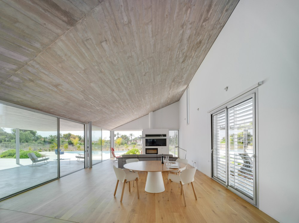 The slanted ceiling adds a modern twist to the design and gives the house character