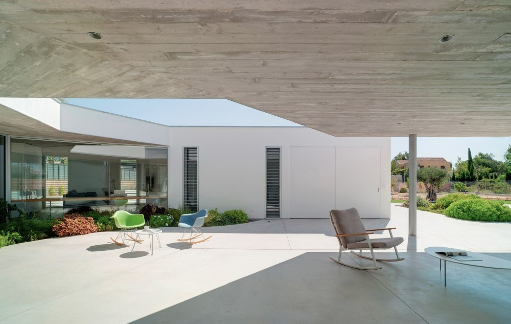 The patio is mostly covered but also has a section that's open to the sky which lets the sunlight into the house