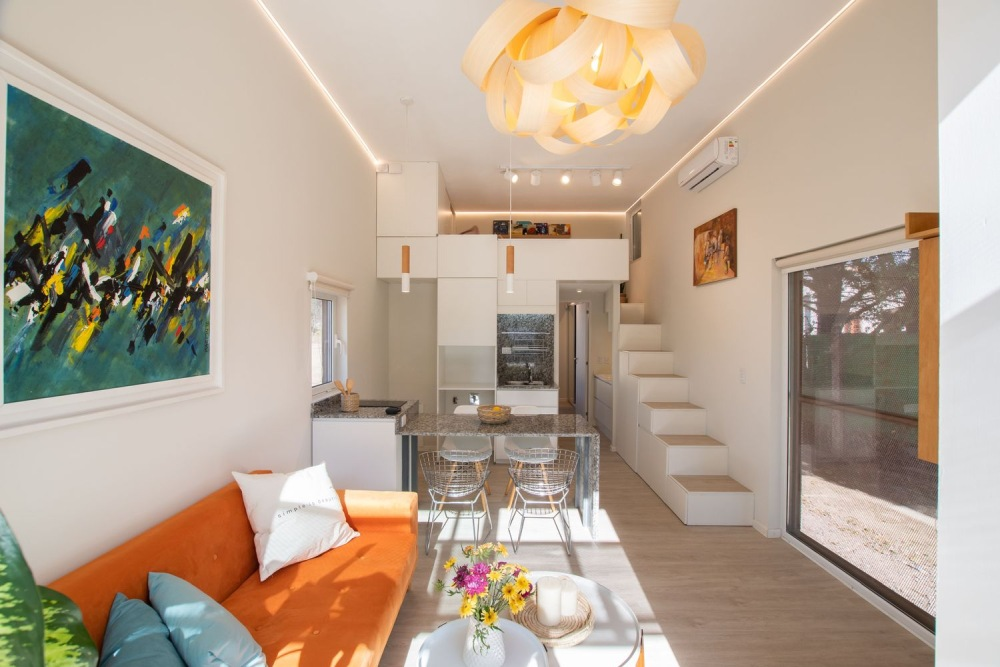 The living area is oriented towards a large window which is intended to serve as a focal point