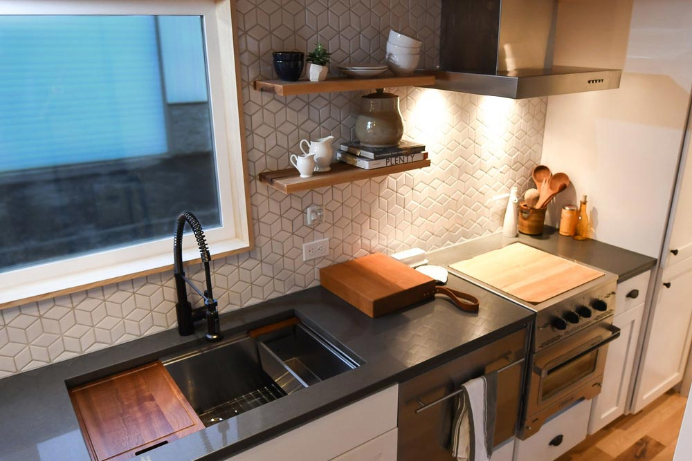 Although small, the kitchen is well-organized and has sufficient space on the counters and inside the cabinets