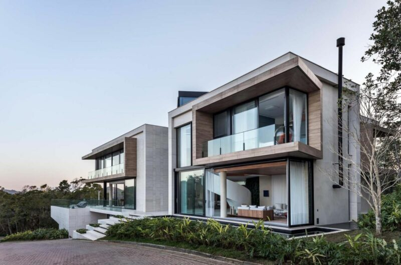 A Modern Home In Itajaí, Brazil With A Cantilevered Swimming Pool