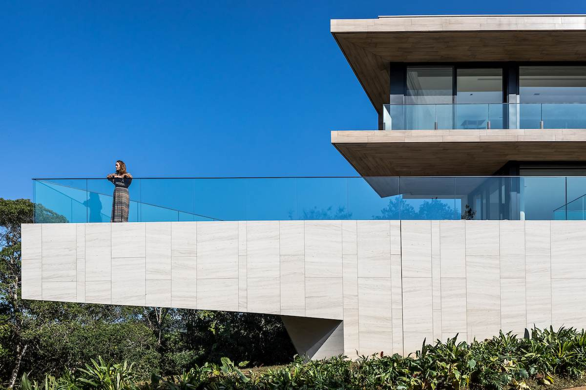 The swimming pool is cantilevered over the sloping hillside and provides a great view over the treetops