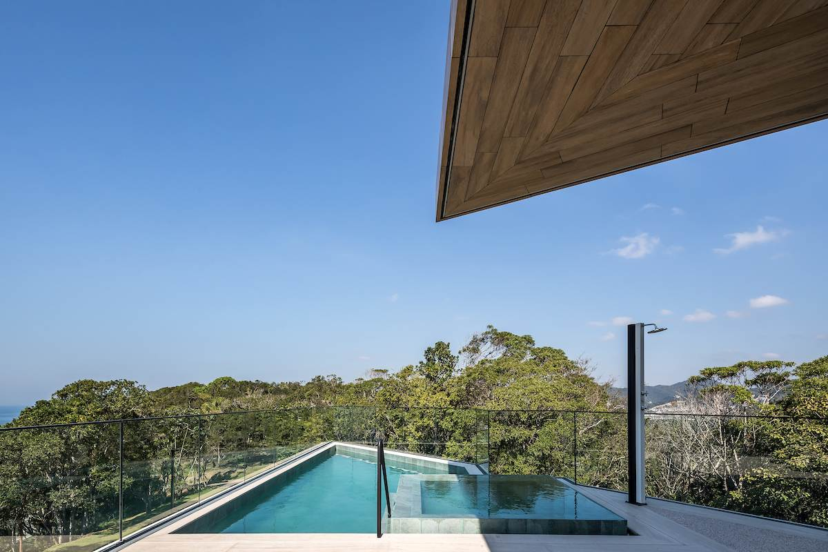 The pool's unusual triangular shape adds to the character of this amazing house