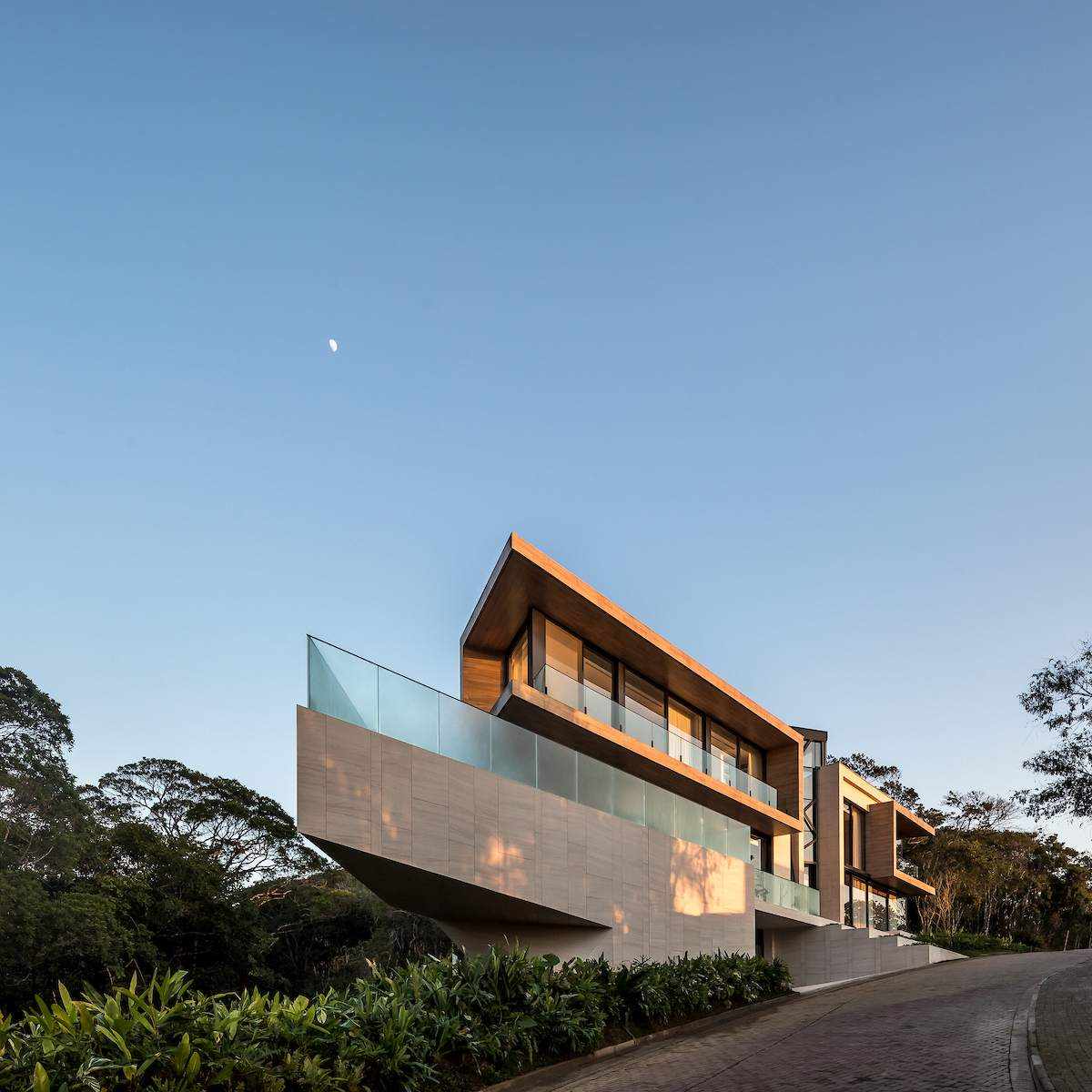 The house is built on a sloping site and the design takes advantage of that
