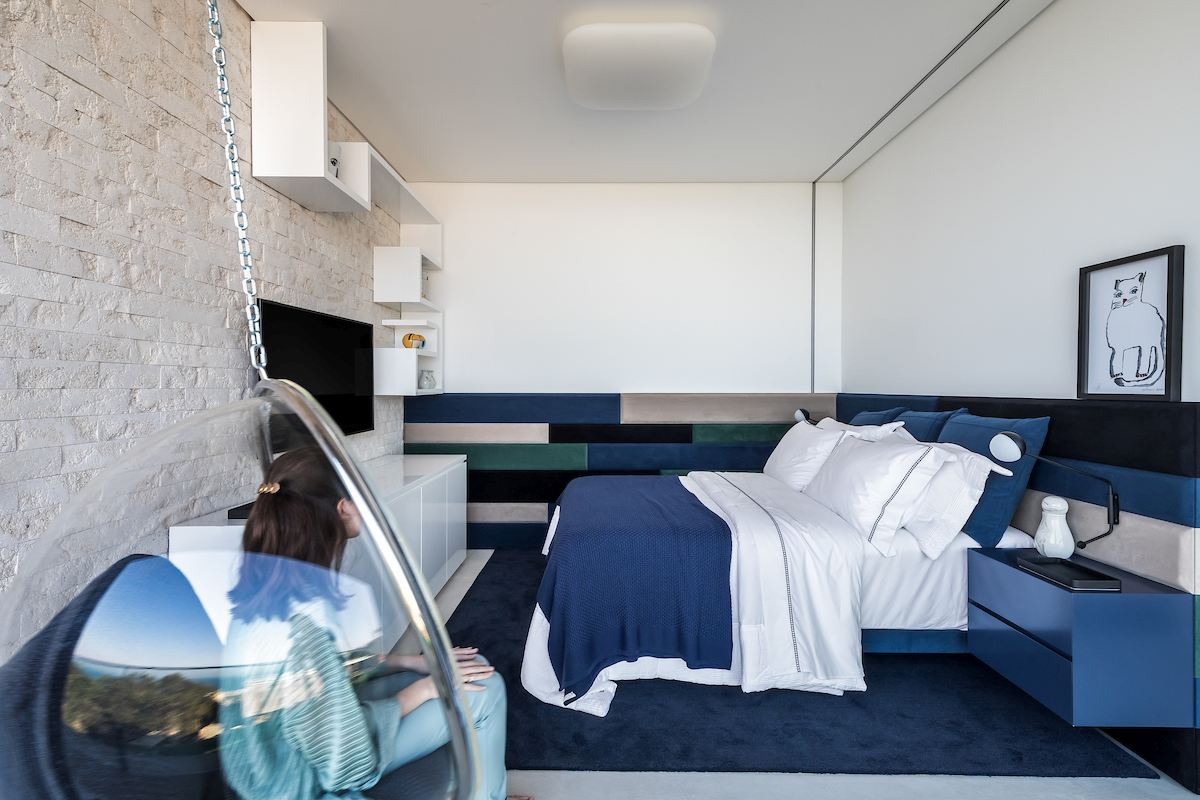 One of the bedrooms has a blue-themed decor, with stylish marine accents and a stone accent wall