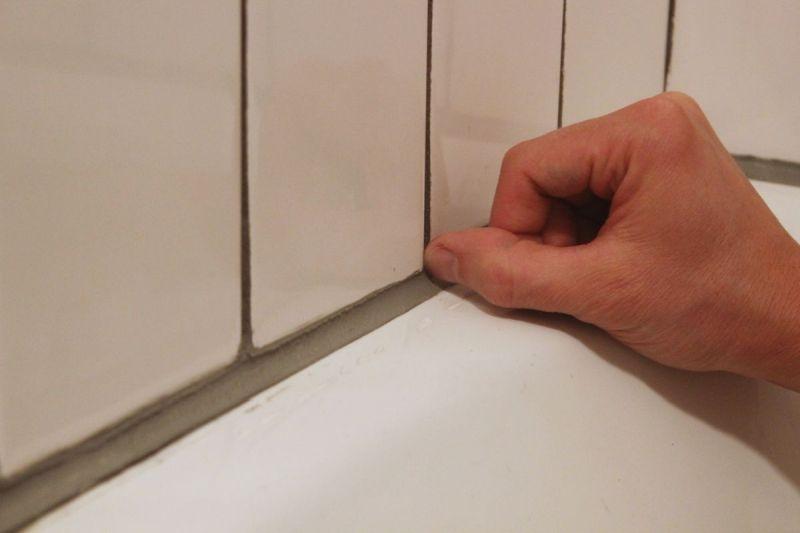 bathroom caulk finger nail