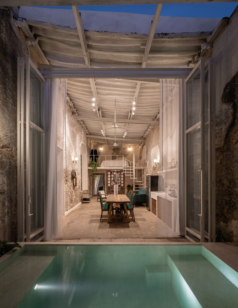 The interior opens up to a small courtyard with a water pool
