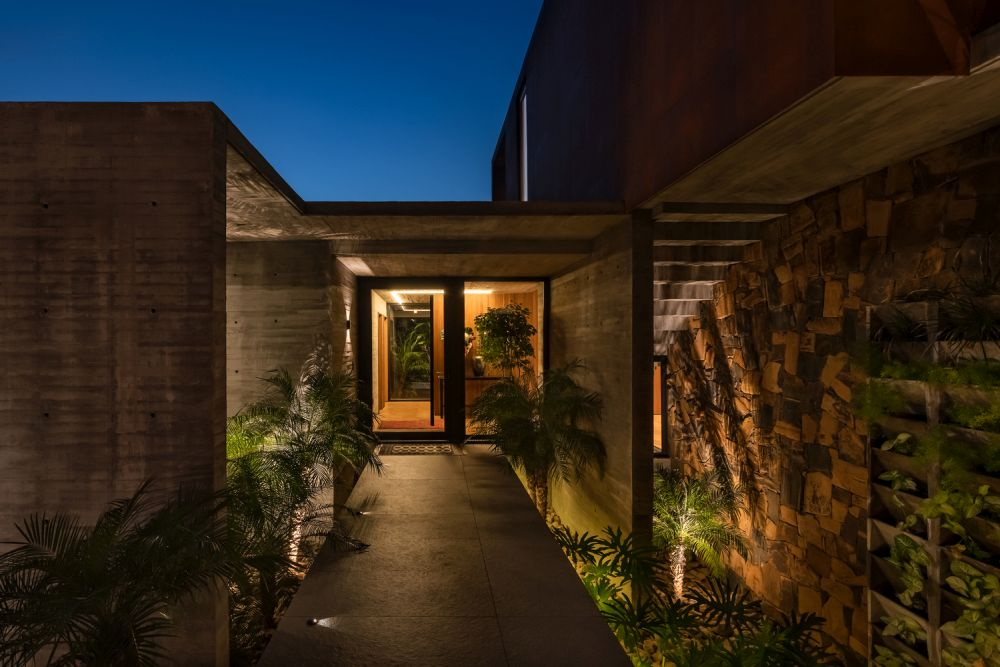 at night, the outdoor lights softly shine onto the walls and create a magical ambiance