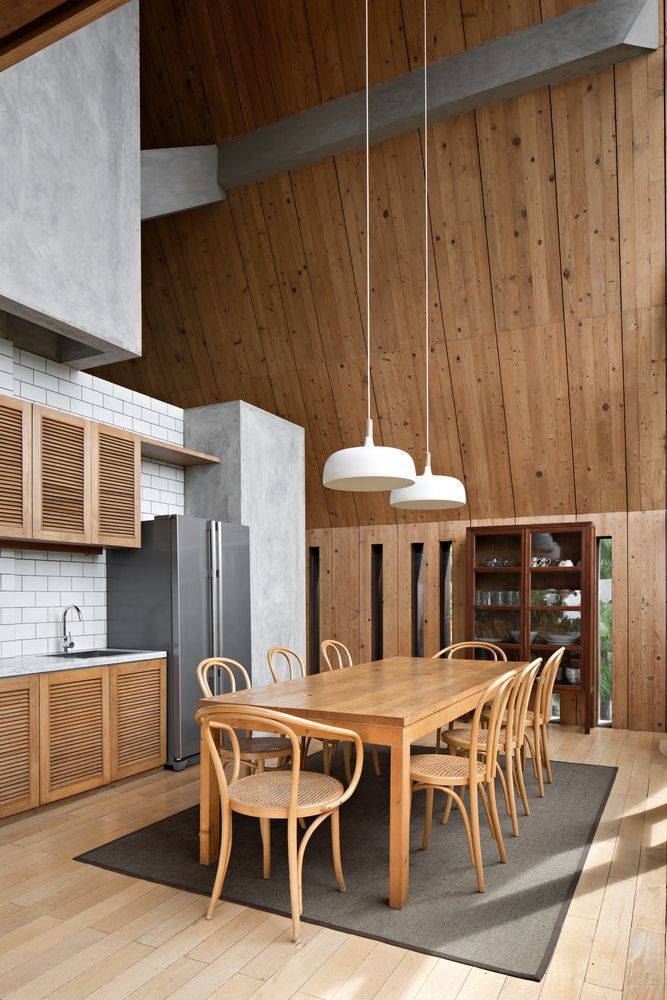 The kitchen and dining room are combined into one big and welcoming space with a big table at its center