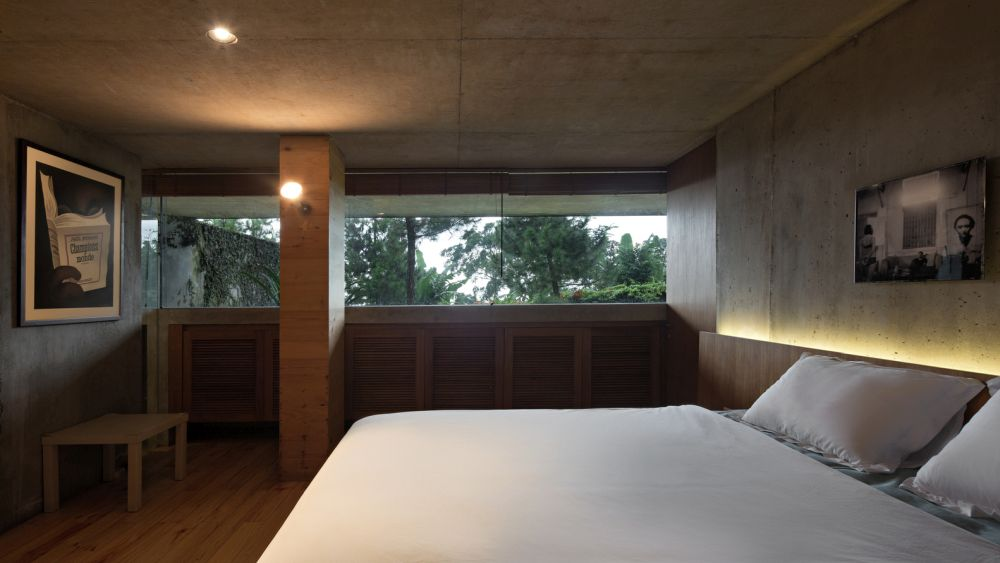 The bedrooms are placed downstairs where they're less exposed to the surroundings