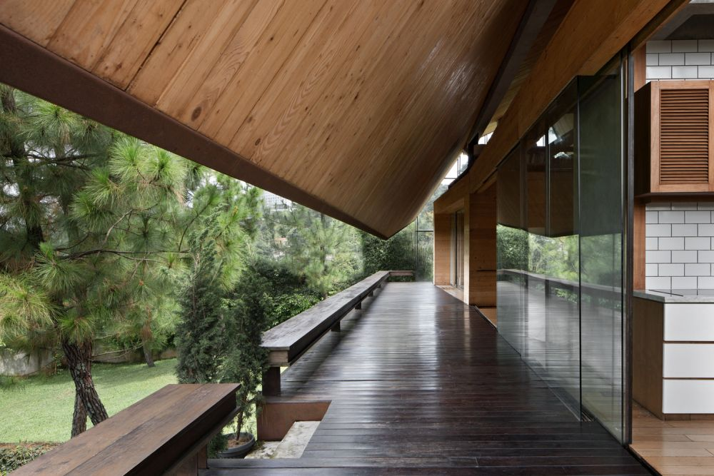 The living room and adjacent spaces have sliding glass doors that open them onto the balcony