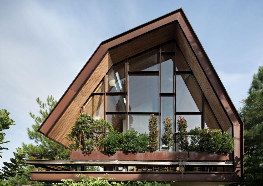 An Asymmetrical Weekend Home In Indonesia Hidden Among Pine Trees