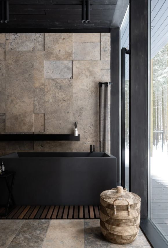 The matte black used as an accent color throughout adds sophistication to the design