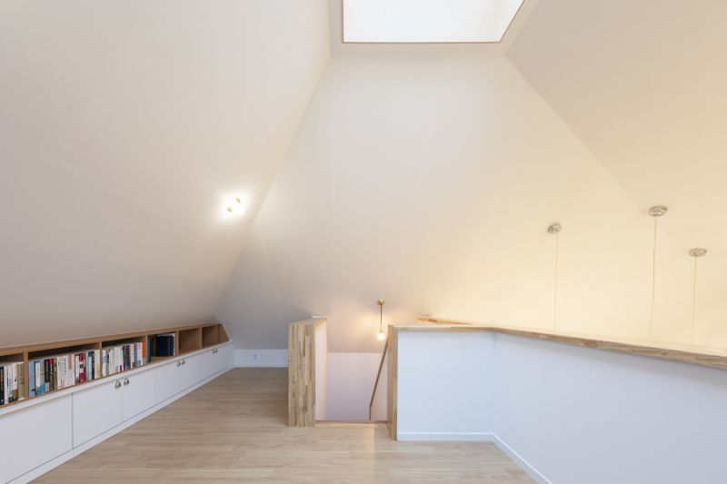 The skylight at the top of the roof lets sunlight into the house and in illuminates the upstairs area