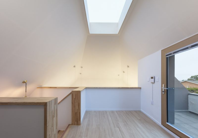 The area upstairs features a small balcony created inside the angled roof
