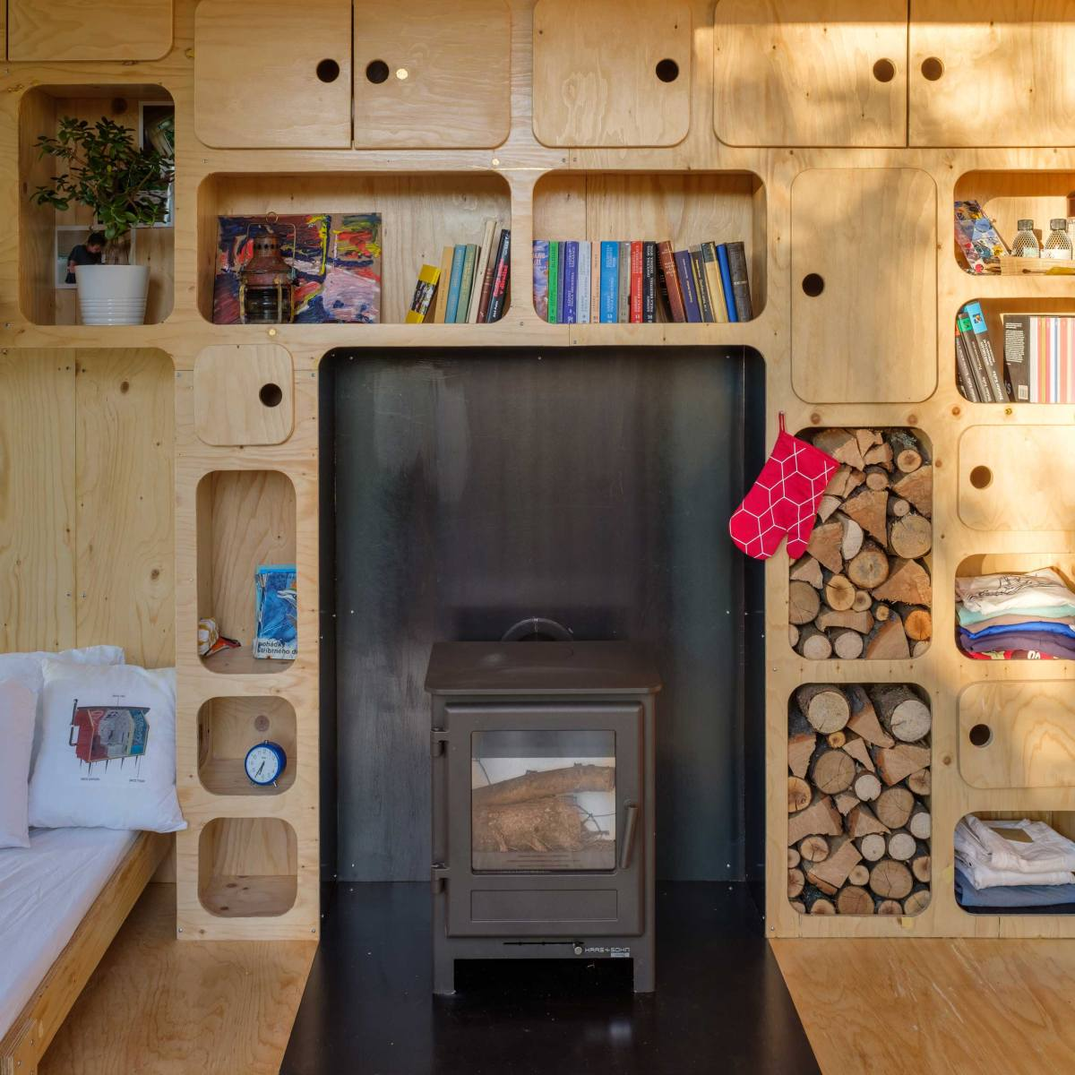 In the main indoor area there's room for a small wood-burning stove which adds a cozy touch to the design
