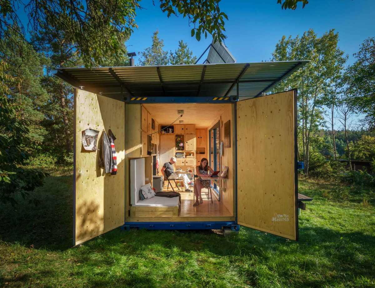 On one of the sides the house can open up to the exterior through the original container doors