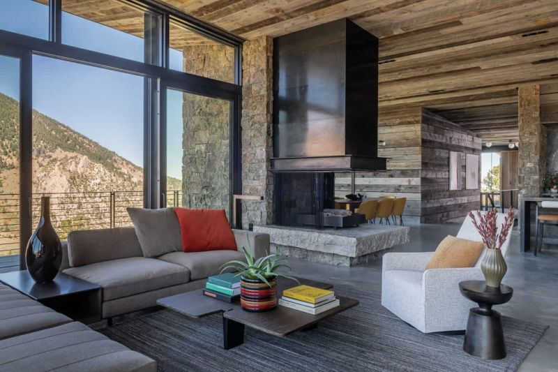 The living area features an indoor fireplace which doubles as a space divider