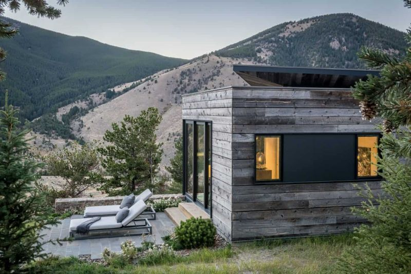 The wood-clad exterior helps the house to blend into the landscape