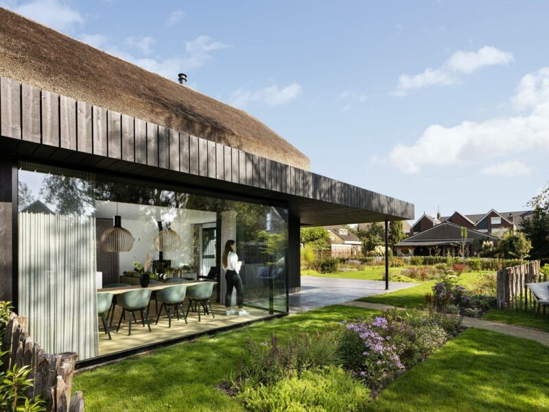A Lovely Dream Home With A Thatched Roof And A Playful Interior