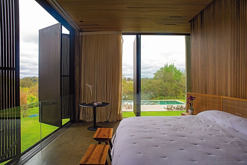 The bedrooms feature vertical folding panels that can opened up to reveal the beautiful outdoor areas