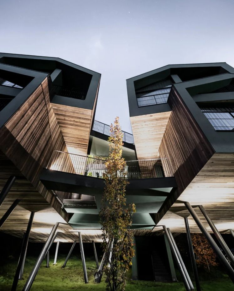 The individual modules are linked together by a series of bridges and feature uniform wooden facades