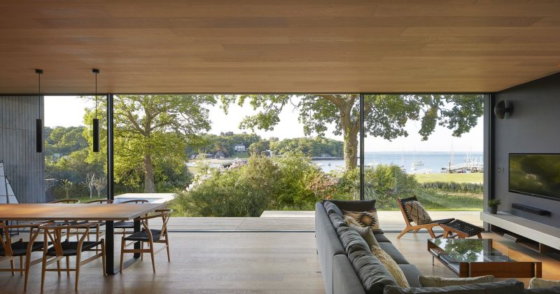 The living room and dining area feature sliding glass door that open them towards the gorgeous scenery