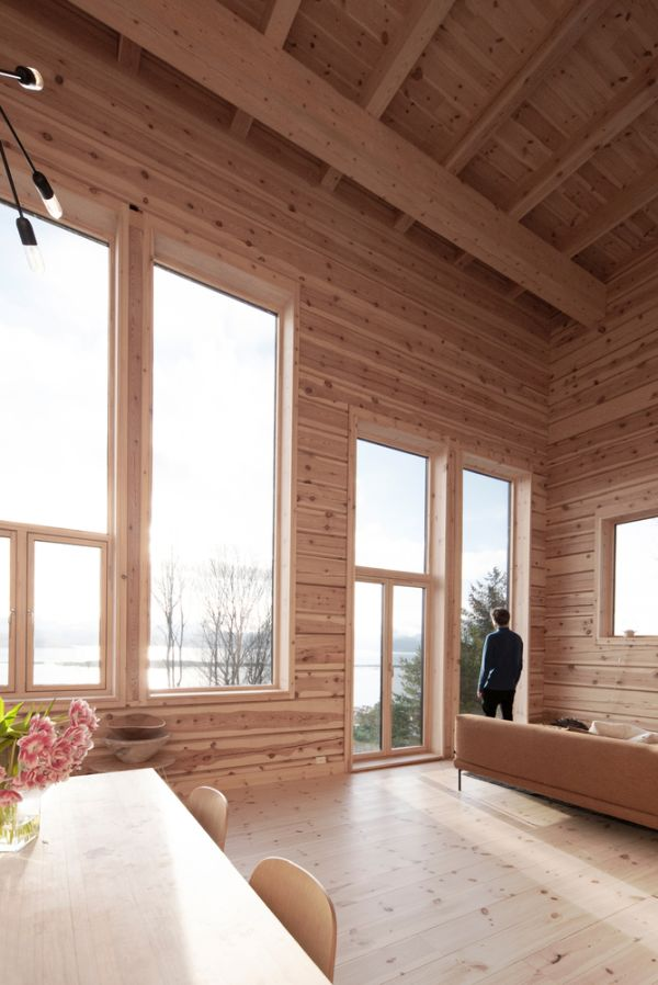 The living room, kitchen and dining area are exposed to beautiful views in three directions
