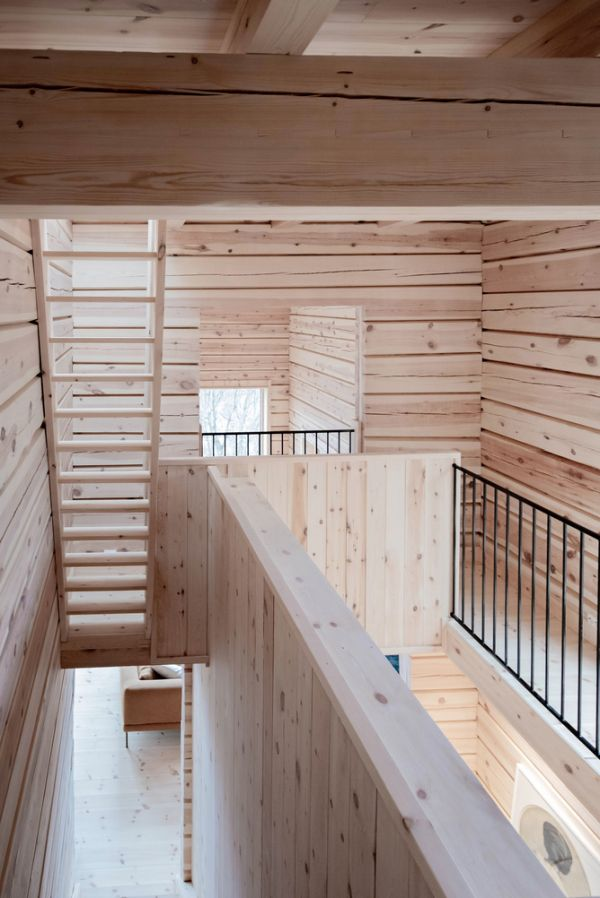 The floors are linked through staircases made of oak and pine wood