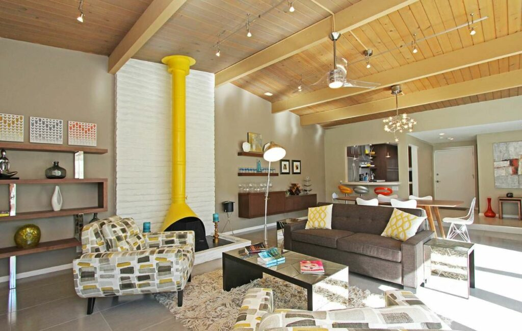 yellow fireplace in large living room visible rafters