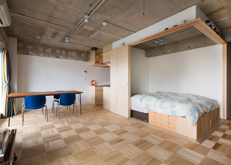 A bedroom inside a wooden