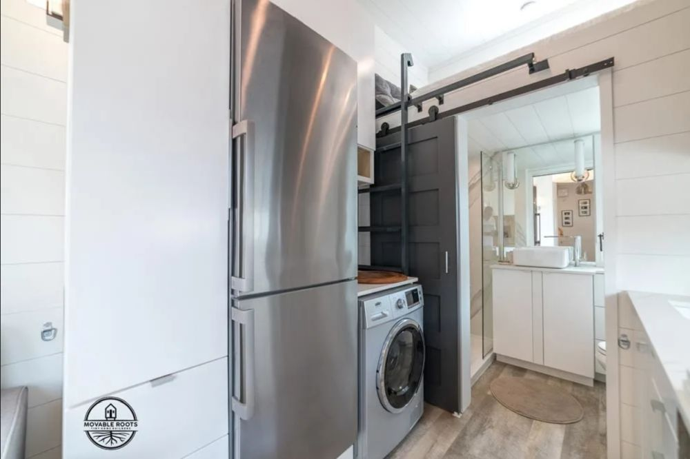 There's also a full-size fridge, a washer and dryer and more storage on the opposite wall