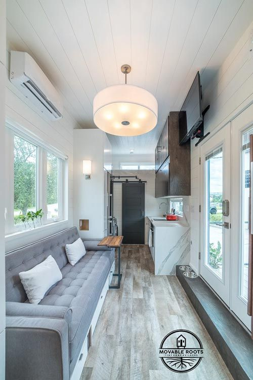 The main bedroom is positioned opposite to the bathroom, on the other side of this tiny house