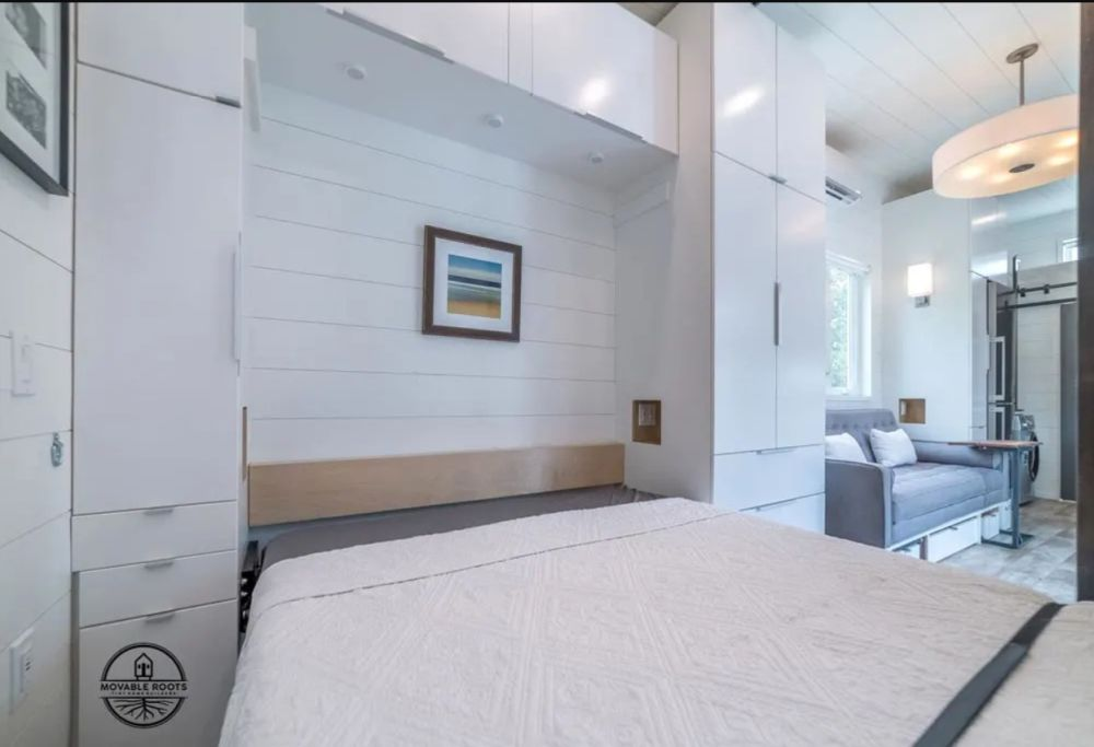 The Murphy bed takes up most of the floor space in this room when it's down
