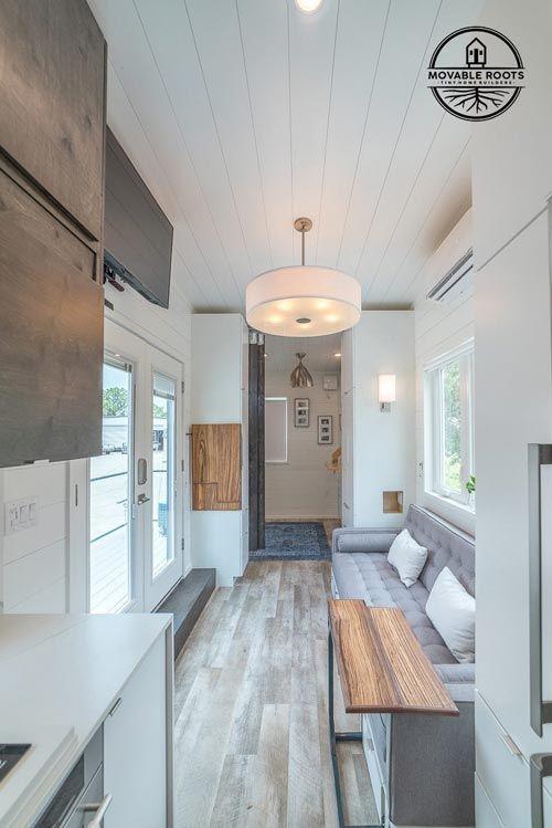 The bedroom features a barn door, just like the bathroom