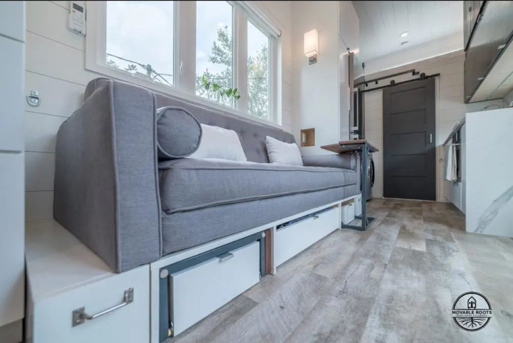 Underneath the couch there's a platform with built-in storage and a slide-out dog bed