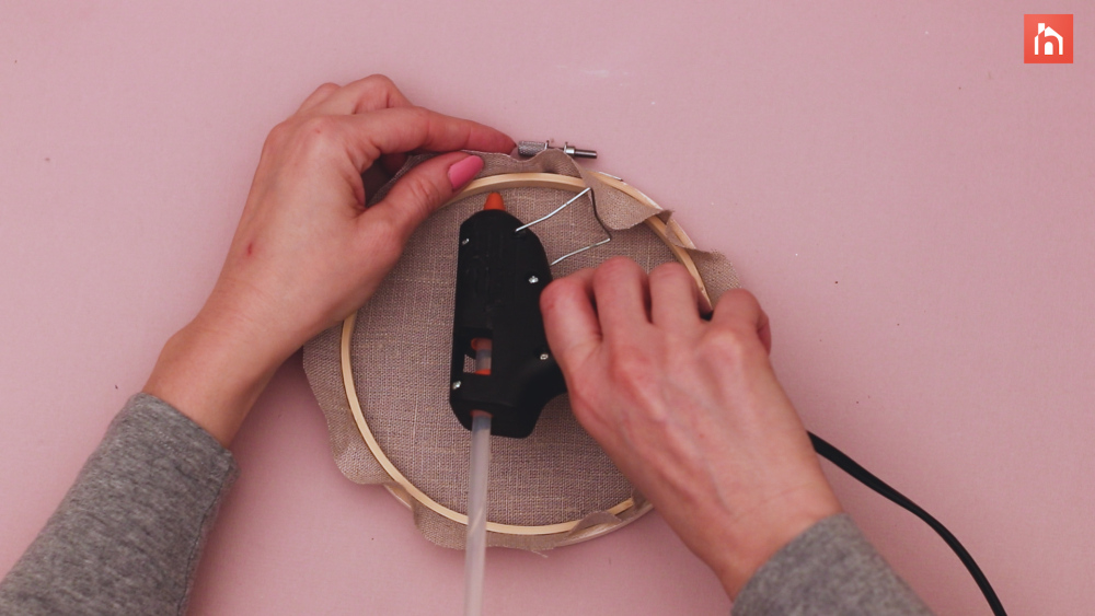 Glue the fabric trim to the hoop