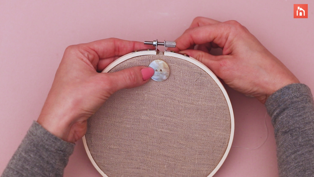 Sew on the large buttons