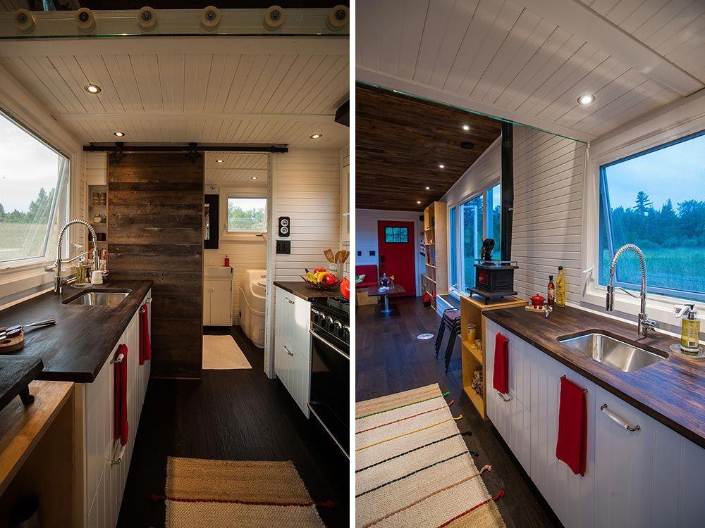 The bathroom is hidden behind a sliding barn door beyond the kitchen area
