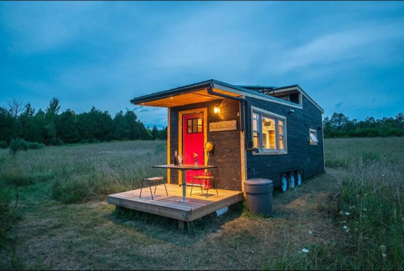 A Tiny House On Wheels That Has Its Own Draw Bridge Deck