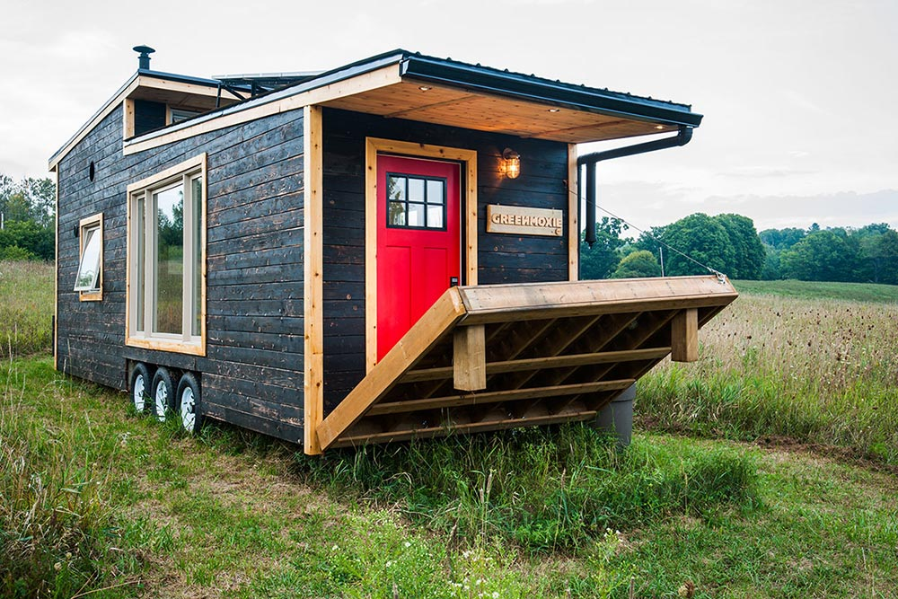 The electric deck can be raised like a draw bridge whenever the house is empty or is being transported