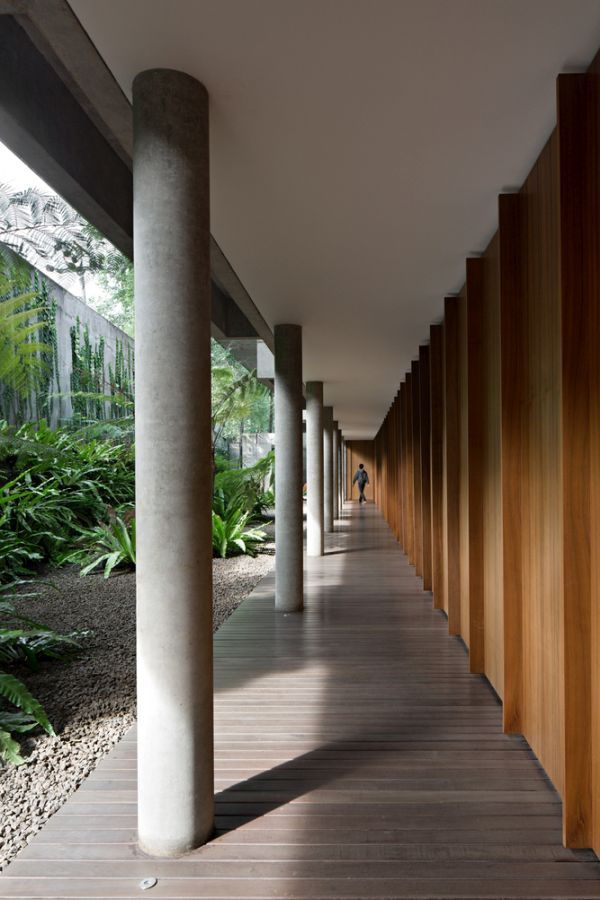 Smooth circular columns frame the terraces and create this beautiful walkway along the house
