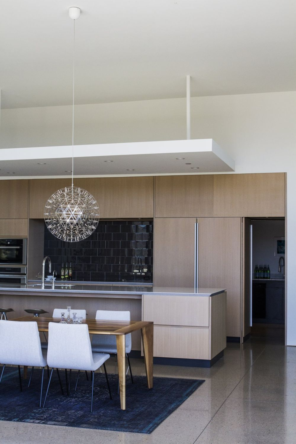 The kitchen, dining are and living room are combined into a big open space and the transition between them in seamless