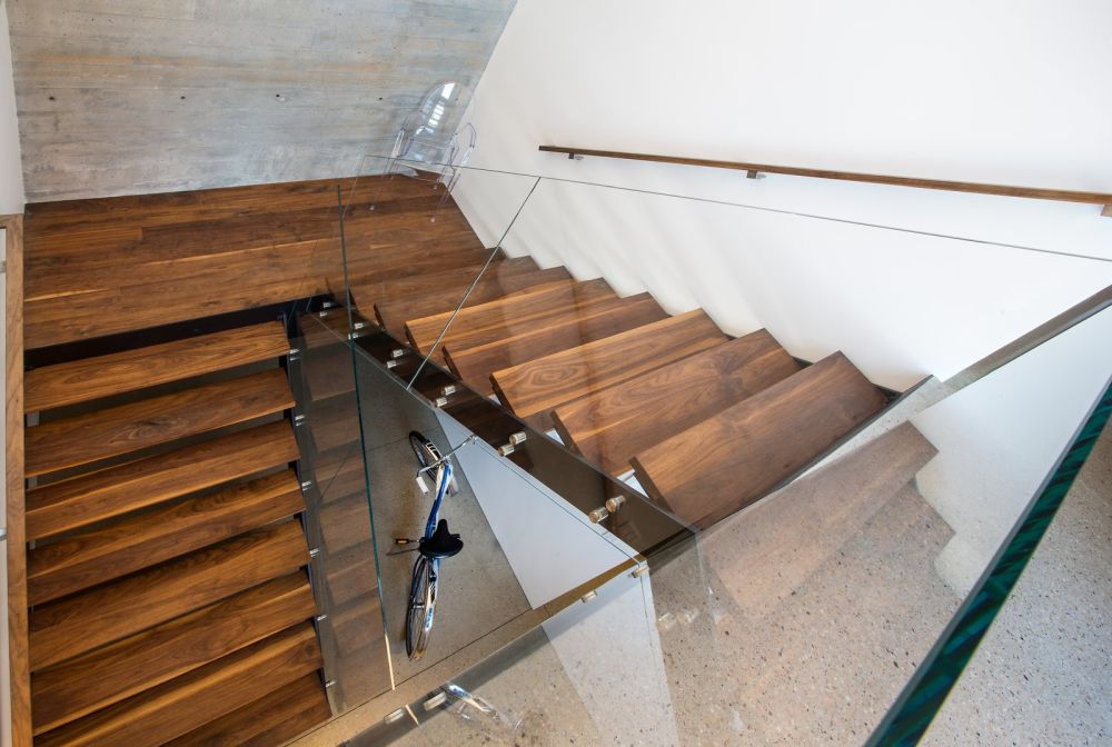This is the staircase which connects the floor and it too is designed using the same main materials